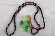 [CHINESE]A LATE 19TH CENTURY JADEITE PENDANT WITH GARNET NECK CARVED WITH THE FIGURE OF KWAN YIN L:28