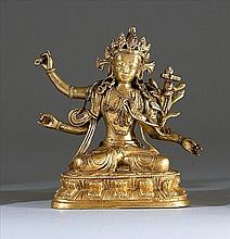 [CHINESE] A LATE 19TH CENTURY SINO-TIBETAN GILT-BRONZE FIGURE In the form of a seated deity on a double lotus throne. Figure with four arms holding various emoluments. H:6