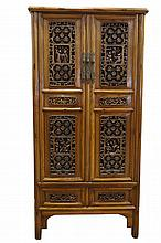 [CHINESE]A LATE 19TH NANMU WOOD CABINET CARVED WITH FIGURES, FLOWRS AND CHINESE CHARACTER