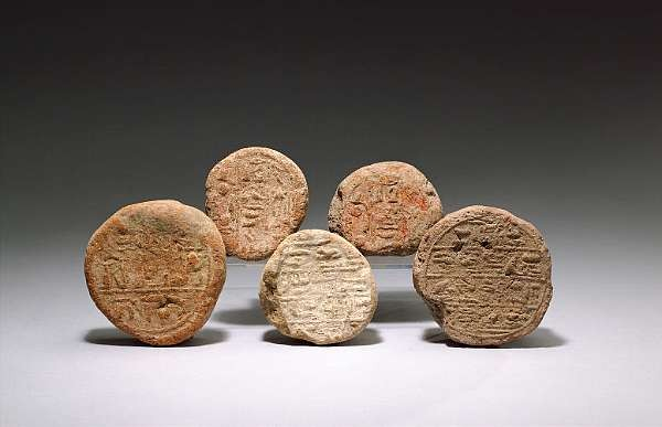 Five Egyptian terracotta funerary cones