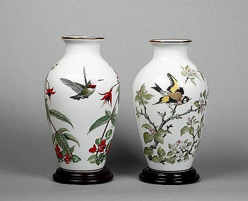 A pair of Franklin Mint Woodland Bird vases