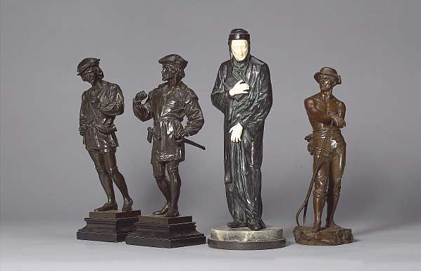 Anatole Guillot (French, 1865-1911): A pair of bronze figures of gentlemen in Renaissance style dress