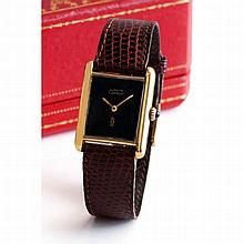 Cartier, Tank Must, n° 6027928, vers 1995.    Une montre rectangula