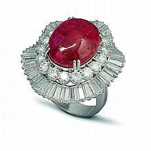 Un ensemble en platine (900‰) composé d'une paire de clips d'oreilles sertie d'un cabochon de rubis traité dans un entourage mouvementé orné de diamants taillés en brillants et baguettes. Et d'une bague sertie d'un cabochon de rubis