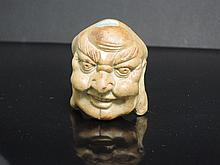 A porcelain head of a Lohan with long ears, the