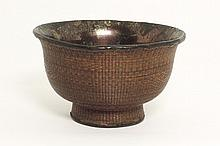 A Chinese bowl with basketry work and silver