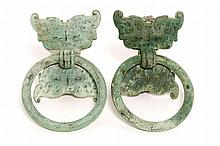 A pair of finely cast bronze Taotie ring handled
