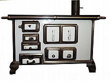 A metal and enamel coal stove