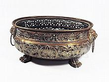 A brass oval jardiniere with pierced body with lion's mask handles, on claw feet ca 1900 wide 38 cm.
