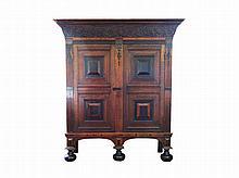 A Dutch oak and ebony two door cupboard, each door with two cushions 17th/18th Century 208 x 183 x 71 cm.