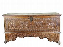 An oak chest the front with four panels with flower sprays in a foliate band inscribed Irmgard Gertraud Hill and dated 1771 147 x 76 x 52 cm.