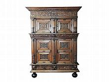 A Dutch oak cupboard the four doors carved with scrolling foliage flanked by fluted colomns 17th Century 218 x 167 x 63 cm.