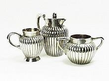 A small silver ribbed water jug, a milk jug and a sugar pot Germany 800 ca 186 gr.