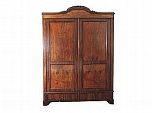 A German mahogany press with shaped cornice and two panelled cupboard doors above two drawers, late 19th Century 215 x 154 x 59,5 cm.