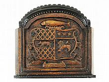 An oak panel carved with a coat of arms, English 19th Century