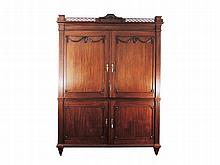 A Dutch LouisXVI mahogany cabinet the top with openwork gallery above two panelled cupboard doors, the lower structure with two doors opening to four long drawers 249 x 182 x 59,5 cm.