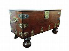 A hardwood colonial chest with plain rectangular top, brass mounts and handles, front ball feet 18th/19th Century