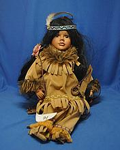 NATIVE AMERICAN PORCELAIN DOLL SWING