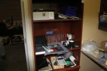 Lot of  office supplies (located on bookcase)