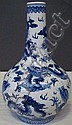 CHINESE PORCELAIN VASE: Blue and white with dragon motifs. Blue character marks to the base.