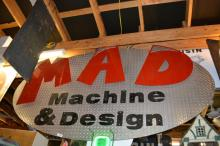 Mad Machine and Design Sign metal
