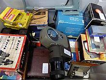 A Box of Camera Flashes and light filters togethe