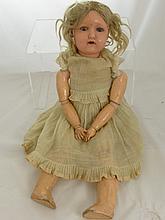 A Heinrich Handwerck Porcelain Headed Doll, stampe