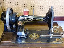 A Frister & Rossmann Sewing Machine in Wooden Case