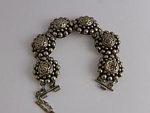 A Lady's Indian Silver Floral Bracelet, approx wt