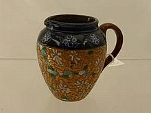 A Royal Doulton Milk Jug, of decorative floral de