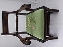 An Antique Mahogany Regency child's dining chair.