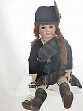An Antique Porcelain Headed Doll, with sleeping e