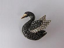 An 18ct Black and White Diamond Swan Brooch, set