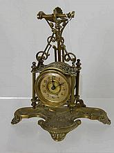 A Victorian brass hanging clock on a stand, the s