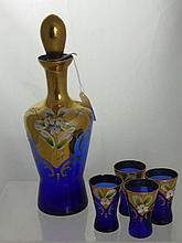 A Blue Bohemian Glass Decanter and six glasses.