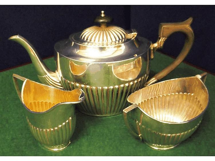 An early 20th Century three piece silver tea