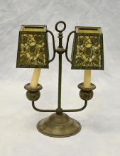 Bronze patinated Bradley & Hubbard double candle lamp, filigree shades with caramel slag glass panels, 14