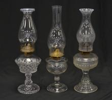 (3) Clear glass oil lamps, tallest 15-3/4