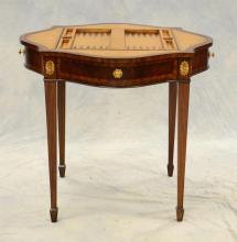 Maitland Smith serpentine shaped leather top Georgian style gaming table with 2 drawers, reversible top with chess and backgammon bo...