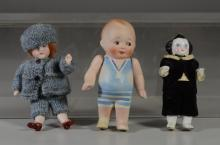 (3) Small boy dolls, bisque marked Nippon, bisque wearing hand knitted outfit, china wearing velvet outfit (repaired leg), tallest 4...