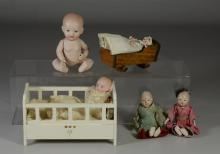 (5) Small all bisque baby dolls, including wooden crib & cradle, 2 Asian, largest 5-1/2