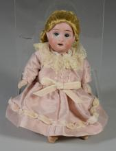 Small German bisque porcelain doll, marked