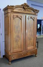 Carved Walnut Victorian 2 Door Armoire, carved shell crest, 2 burled paneled doors, divided interior with shelves on one side, two d...