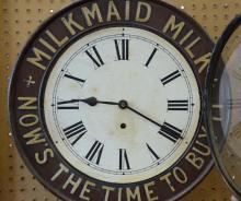 British United Clock Company embossed tin and wood advertising clock,