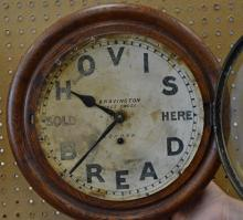 Round oak English advertising clock,