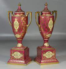 Pair of Royal Vienna transfer decorated urns with lids, signed Angelica Kauffman, one marked