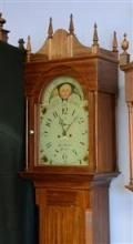 Mahogany PA 8 day tall clock by Jacob Guthart, 1779-1867, Lebanon, scalloped top with 4 candle finials, rectangular waist door with ...
