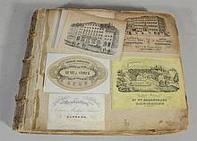 Scrapbook of over 200 European tradecards, labels, and checks, primarily French and German, belonging to Ferdinand Moras (German/Ame...