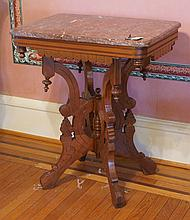 Carved Walnut Victorian Eastlake style brown marble top table, 19