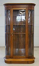 Oak display cabinet with bowed glass ends and flat door, wood back and shelves, 44